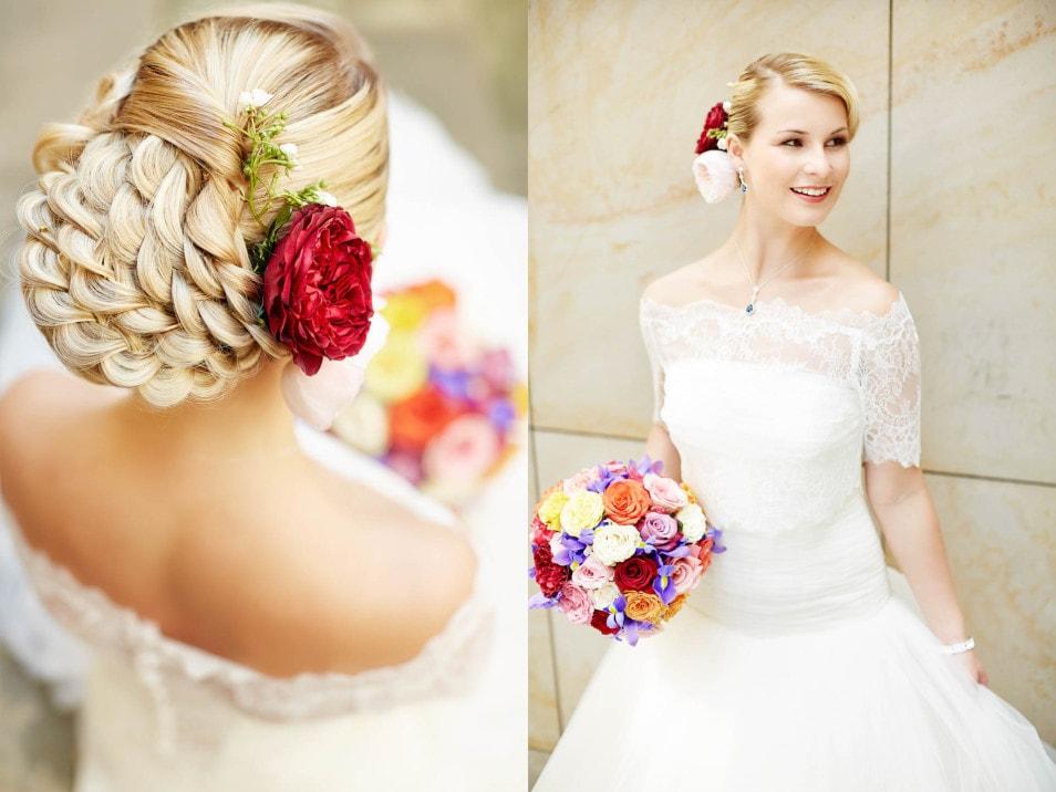 wundervolle Brautfrisur mit Blüte im Haar