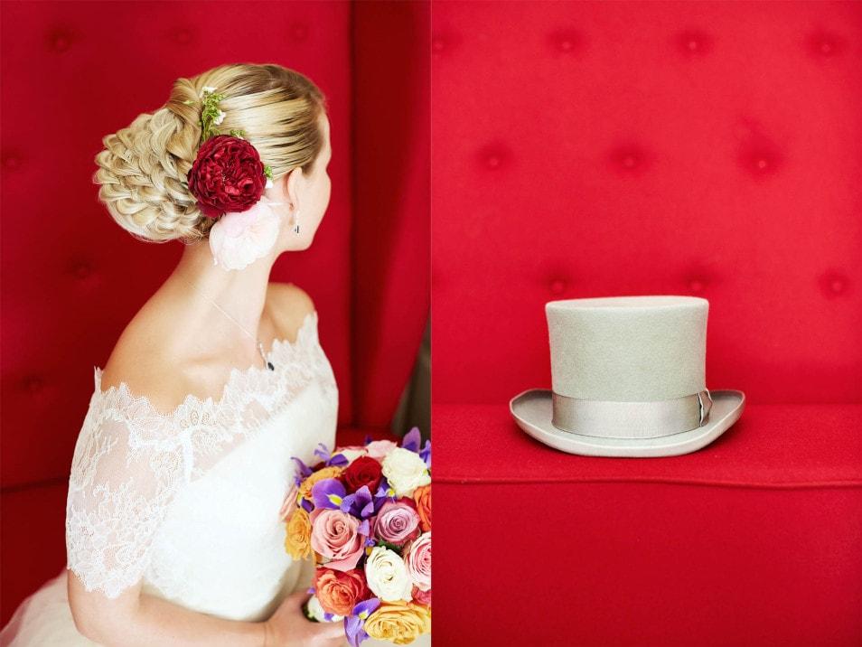 aufwendige Brautfrisur mit Blume und Dutt
