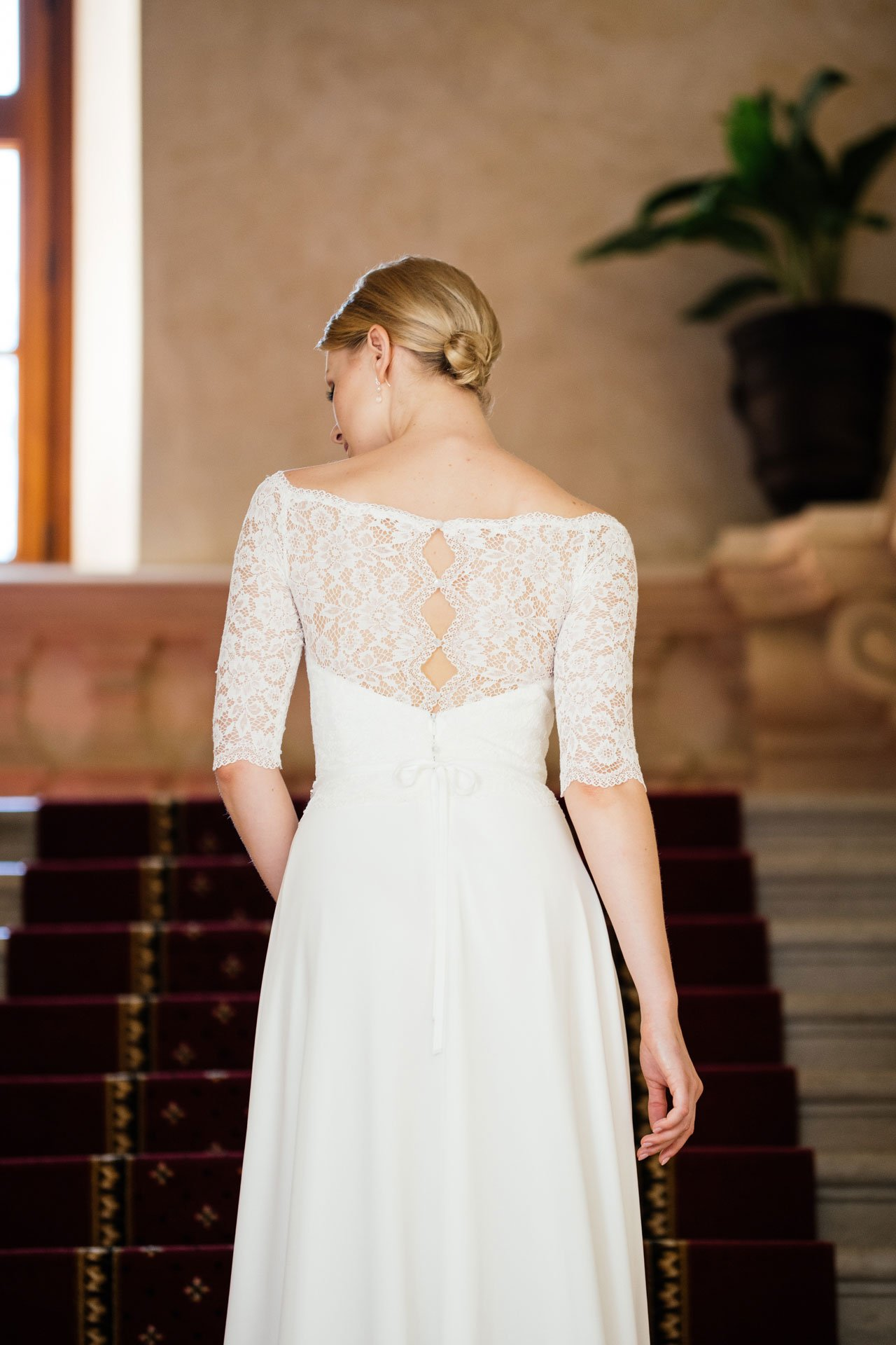 Brautkleid Spitze Ärmel – besonderer Rücken