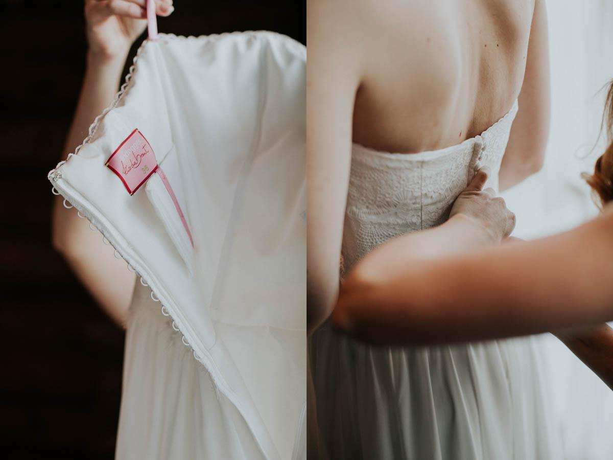 Brautkleidlabel und Braut beim Anziehen