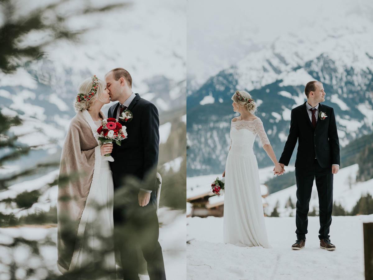 Brautpaar küsst sich im Schnee