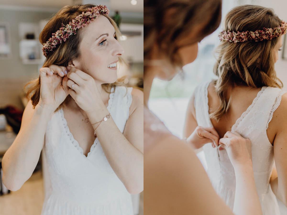 Braut zieht sich Ohrringe an